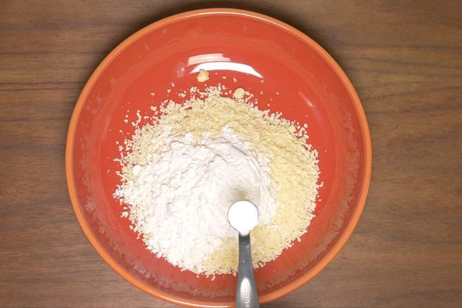 Add grated mawa, maida, cardamom powder