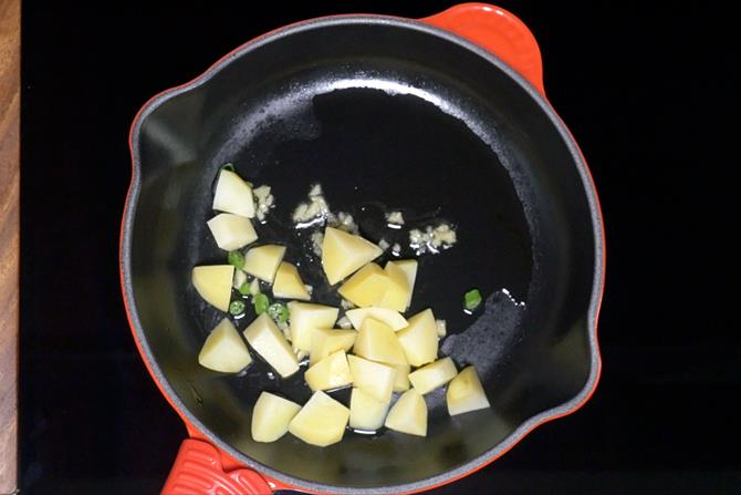 adding boiled cubed potatoes to make aloo chaat recipe