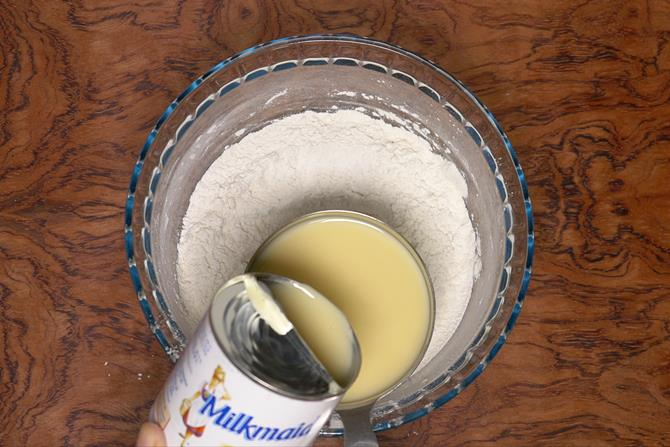 Pouring condensed milk to make eggless vanilla cake