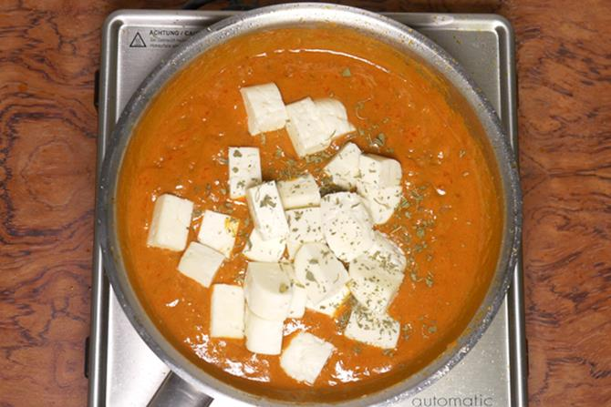 adding paneer to make paneer do pyaza