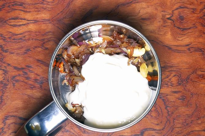 adding yogurt to make paste for chicken korma