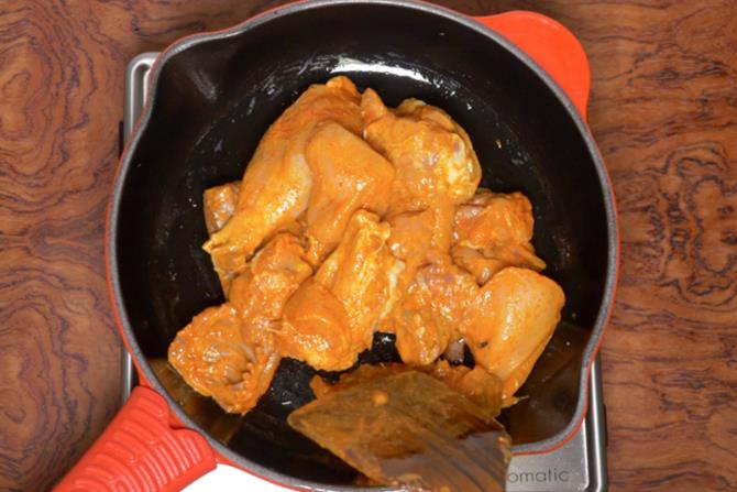 frying chicken to make korma