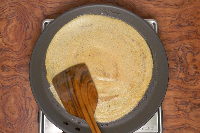 flipping the mixed dal dosa