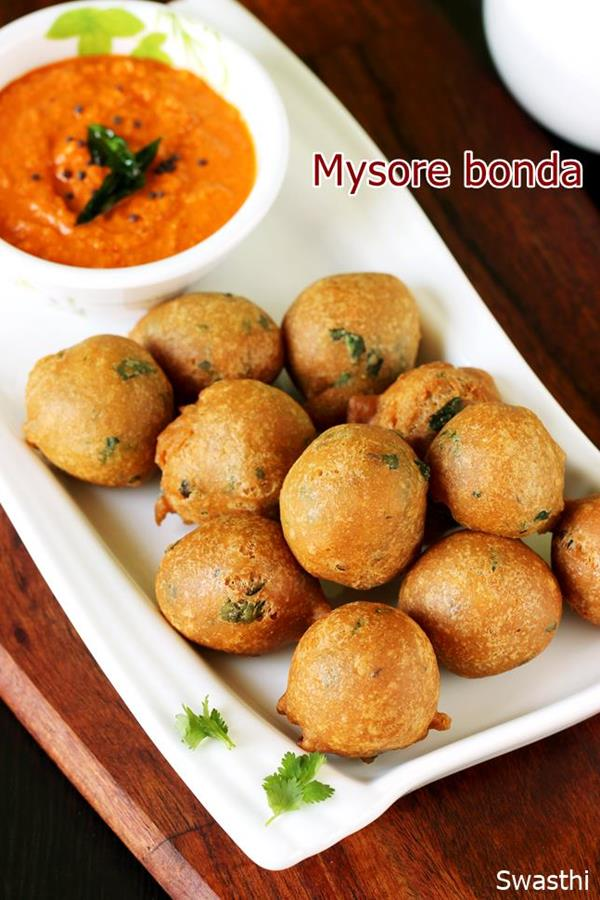 mysore bonda is a quick Indian snack made with flour, yogurt & spices. Serve mysore bonda with any chutney #bonda #mysorebonda #bondarecipe