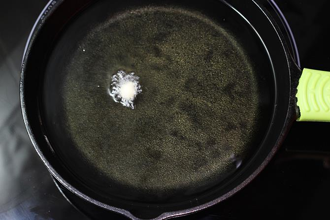 Heat oil in a deep pan