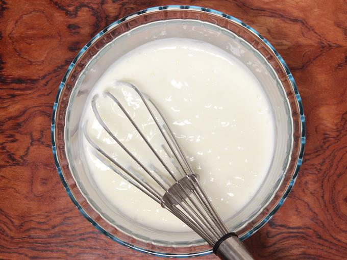 whisking curd to make salt lassi