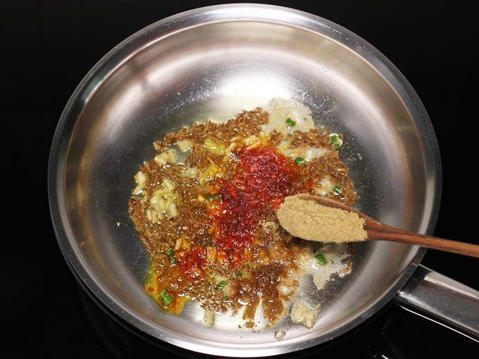 adding coriander powder to make jeera aloo