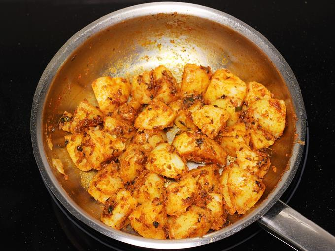 Frying potatoes to make jeera aloo