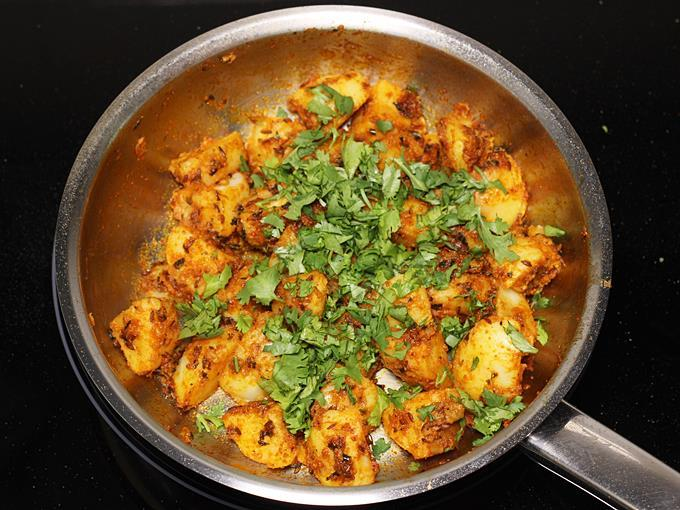 sprinkle coriander leaves to make jeera aloo