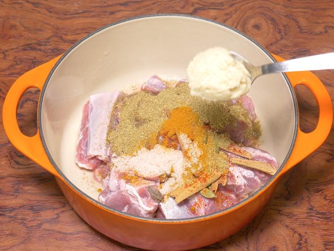 adding ginger garlic paste to make lamb korma