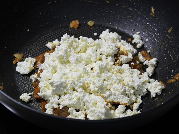 adding crumbled paneer
