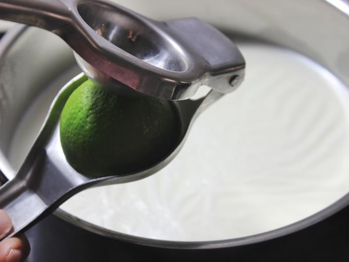squeezing lemon juice to make kalakand