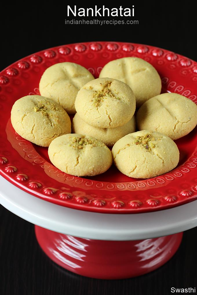 Nankhatai are Indian shortbread cookies made with flour, ghee, sugar and cardamom powder. These are great to have with a cup or milk or tea. #nankhatai #nankhatairecipe