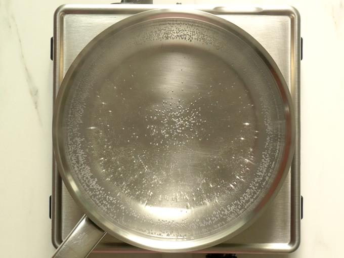boiling water in a pot for rava kesari recipe