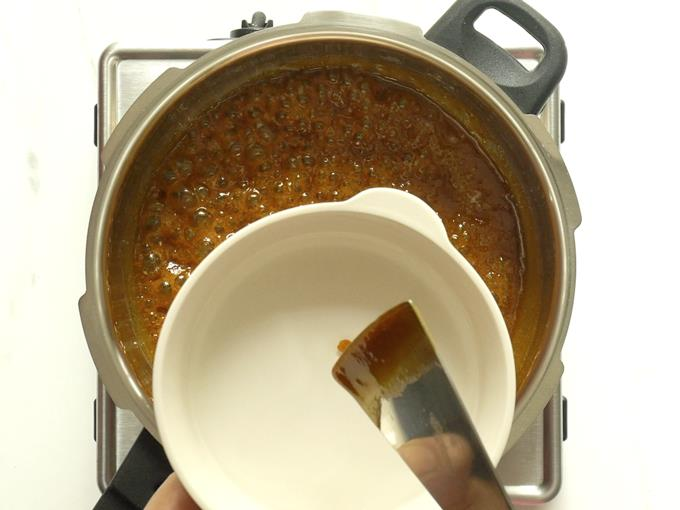 checking syrup for consistency to make chikki recipe