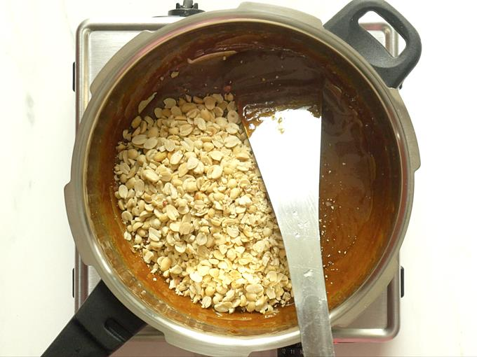 mix peanuts with jaggery syrup to make chikki recipe