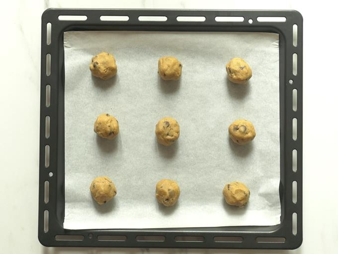 Divide the dough to 9 parts and place them on a parchment paper