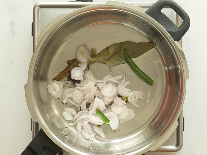 frying onions ginger to make mushroom biryani