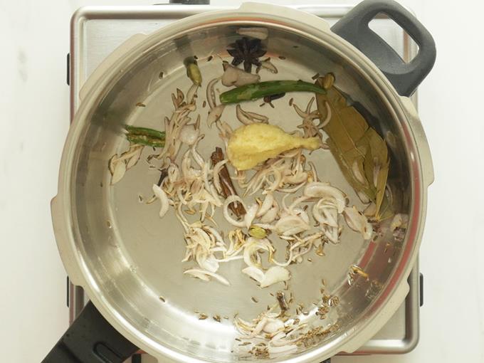 frying ginger garlic paste to make mushroom biryani