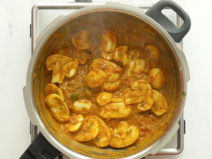frying mushrooms to make mushroom biryani