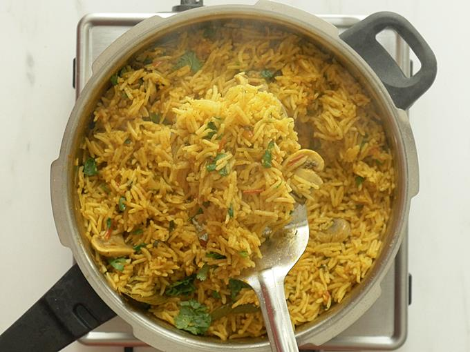 fluff up the mushroom biryani with a fork