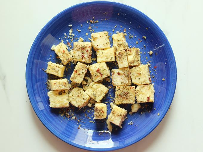 toss cheese cubes in spice mix to make cheese balls