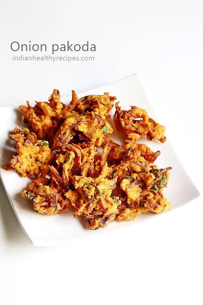 onion pakoda recipe - pakoda are crunchy deep fried fritters made with gram flour, onions & some spices. Enjoy onion pakoda as a tea time snack. #onionpakoda #pakoda #pakodarecipe #onionpakora