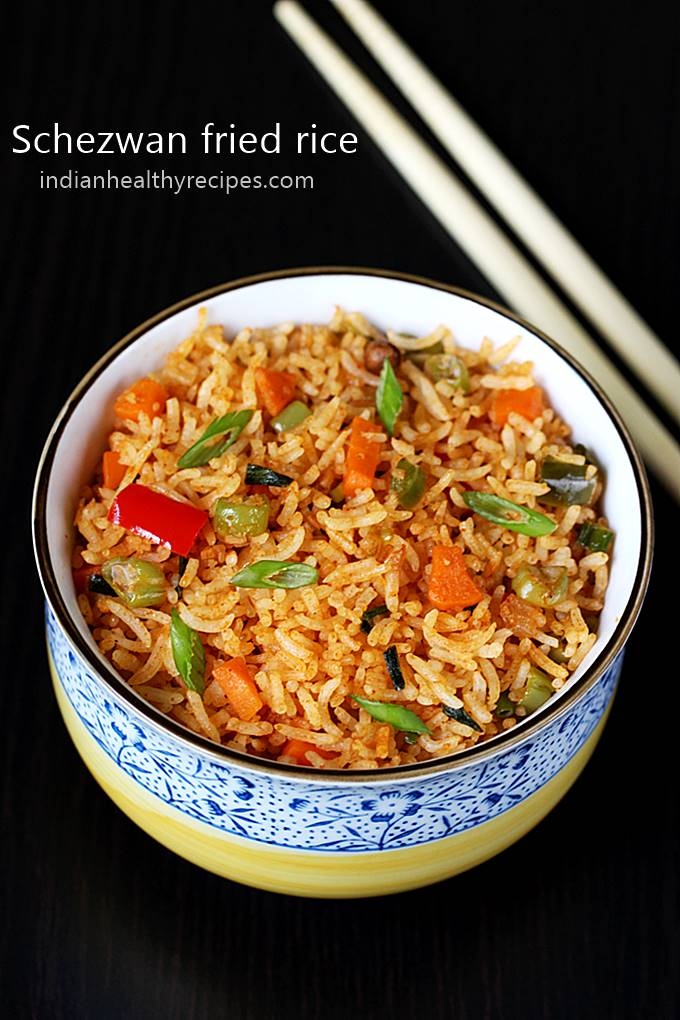 schezwan fried rice is a spicy flavorful & delicious vegetarian rice. Recipe includes making schezwan sauce for the rice. #schezwanfriedrice #schezwanfriedricerecipe #schezwanrice