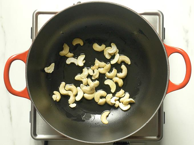 frying cashews till golden to make semiya payasam