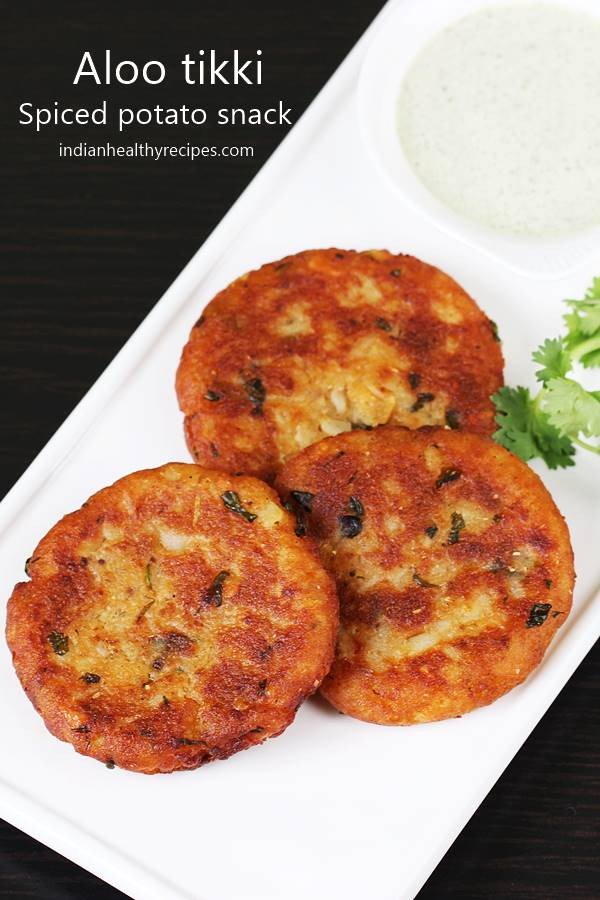 Aloo tikki is a popular Indian snack made with boiled potatoes & spices. They are eaten with green chutney or can be topped with yogurt & chutney #alootikki #alootikkirecipe