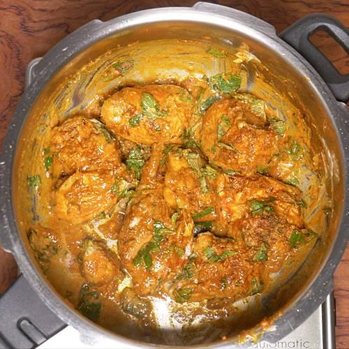 layering chicken for chicken biryani