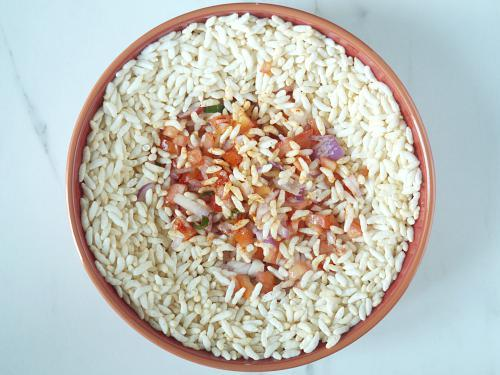 mixing ingredients to make churumuri