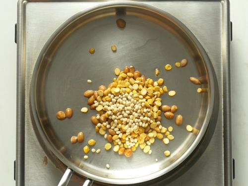 frying dal peanuts to make ginger chutney
