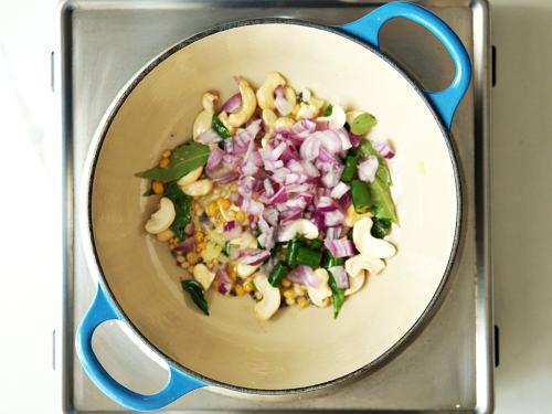 adding onions chilies to make khara bath