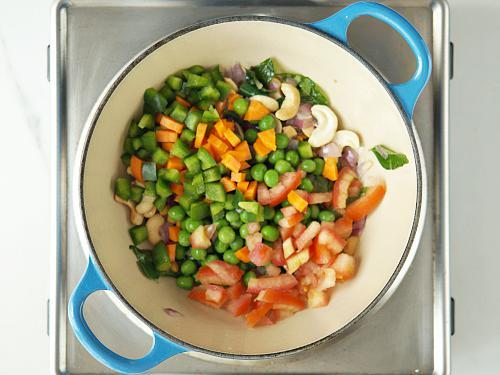 adding all veggies to pan for khara bath recipe
