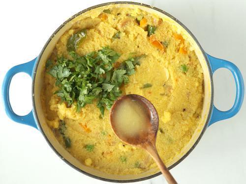 adding ghee and coriander