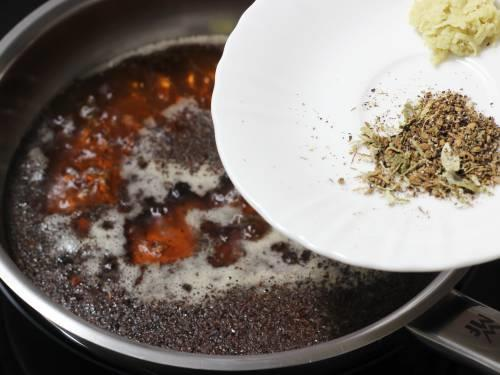 adding ginger and spice powder to make masala chai tea
