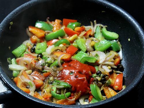 adding sauces to make schezwan chicken