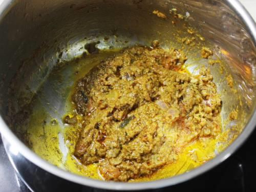 frying masala until aromatic to make vegetable biryani