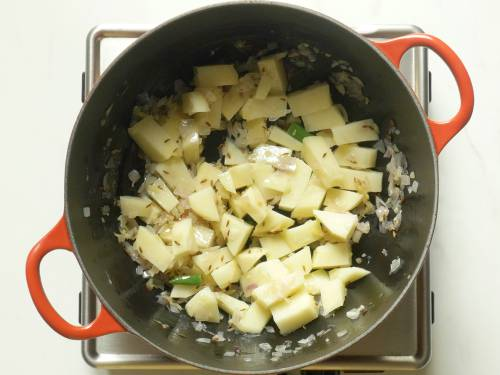 frying potatoes to make aloo gobi