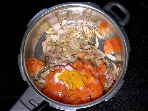 adding tomatoes turmeric salt