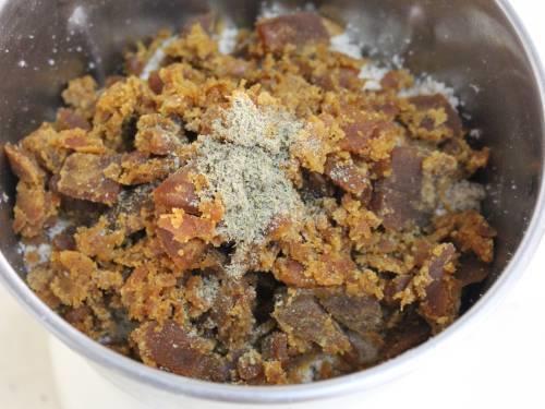 adding jaggery cardamom for almond ladoo