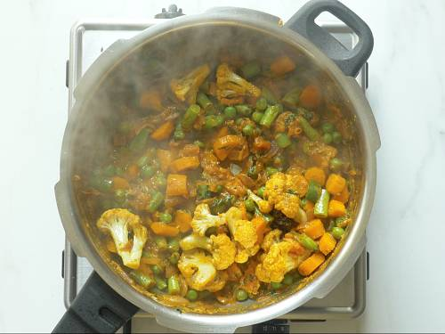 frying veggies to make veg biryani