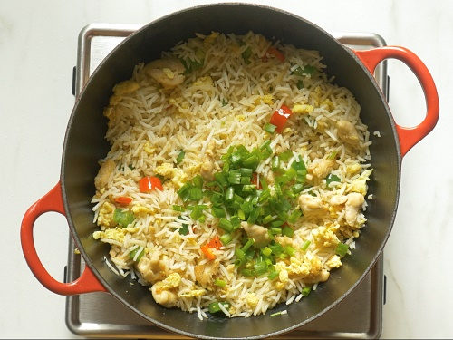 frying chicken fried rice with scallions