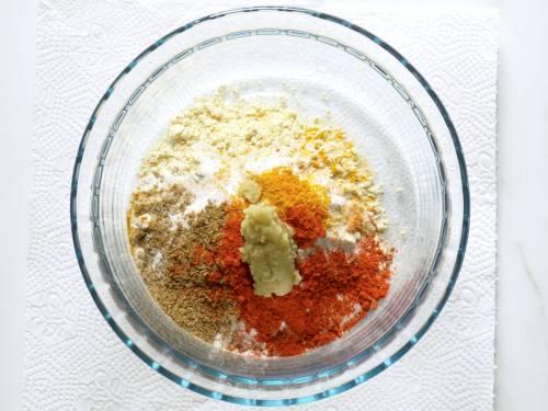 adding pakora ingredients