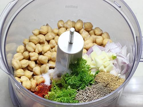 processing chickpeas herbs spices in a food processor