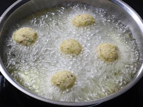 deep frying falafel in hot oil