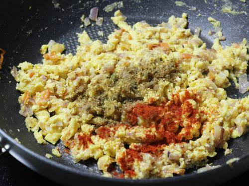 adding chilli powder and masala for egg bhurji