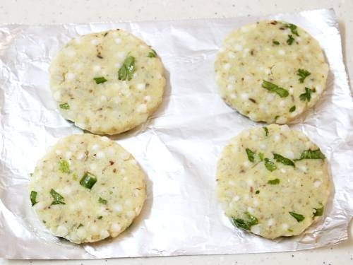 making sabudana vada on a foil