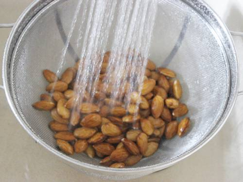 rinsing almonds for making barfi